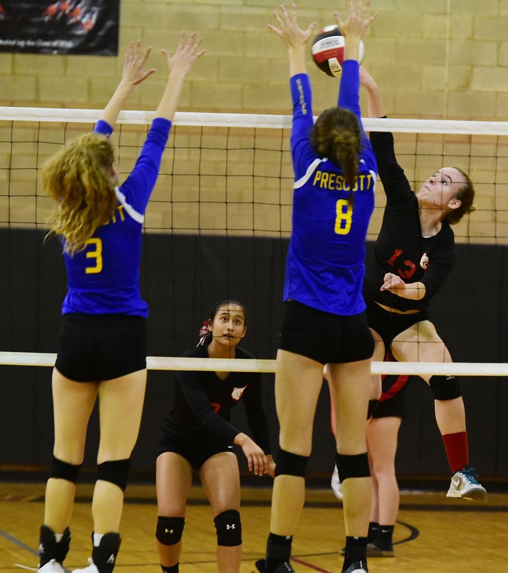 Prescott's Danielle Dreher (8) and Daphne Skinner (3) try to block Jordyn Moser (13) as Bradshaw Mountain hosted cross-town rival Prescott in a volleyball matchup Thursday, September 14 in Prescott Valley. (Les Stukenberg/Courier).