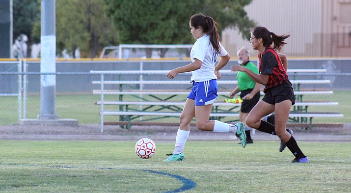 Camp Verde junior Tyra Smith dribbles past the Page defense en route to her first of three goals against the Sand Devils on Tuesday night at home. Smith also had a brace in Camp Verde's 5-1 win at Holbrook. (VVN/James Kelley)