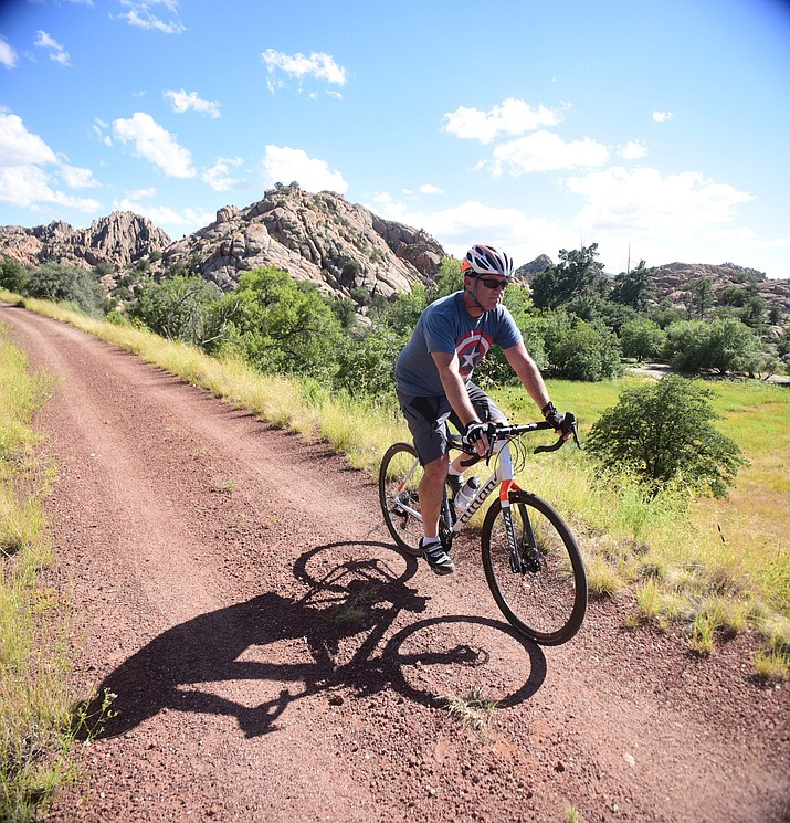 Matt Fay of Prescott Valley rides along the Peavine Trail Thursday, Sept. 14, on stretch north of the Point of Rocks that is being eyed for residential development by Arizona Eco Development. (Les Stukenberg/Courier)