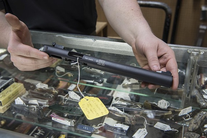 Gun silencers, or suppressors, are the stuff of legend, wielded by hit men and by James Bond. For decades, buying a silencer for a firearm in the United States has been as difficult as buying a machine gun, requiring a background check that can take close to a year. There has been a renewed push by some groups to ease those restrictions. In Arizona, suppressors have been permitted for huntering since 2012. (AP Photo/Lisa Marie Pane)