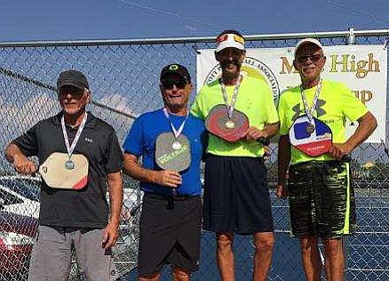 From left to right: Keith Maland, Cris Olson, Kevin Costa and David Porubcan stand atop the podium after claiming gold (Costa/Porubcan) at the Mile High Pickleball Tournament on Sept. 10 at Pioneer Park in Prescott. (Prescott Pickleball Association/Courtesy)