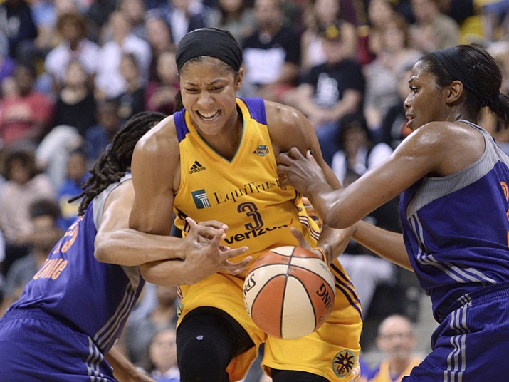 Los Angeles Sparks' Candace Parker (3) is fouled by Phoenix Mercury's Monique Curry (25) as Mercury's Camille Little helps on defense during the first half of Game 2 of WNBA basketball playoff semifinal, Thursday, Sept. 14, 2017, in Long Beach, Calif. (Stephen Carr//Los Angeles Daily News via AP)