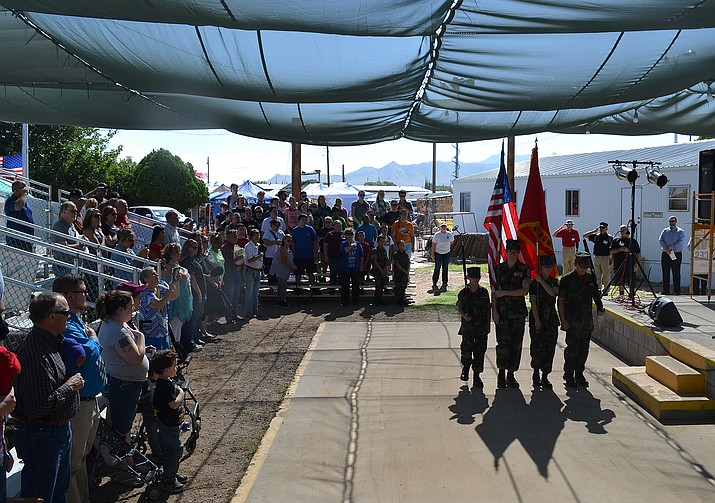 The Kingman Young Marines Color Guard marches into place for the fair's opening ceremony Thursday.