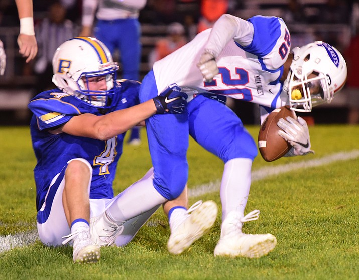 Prescott's Aaron Greene (4) brings down the runner for a loss as the Badgers play Moon Valley in the 2017 Homecoming game Friday, September 15 in Prescott. (Les Stukenberg/Courier).
