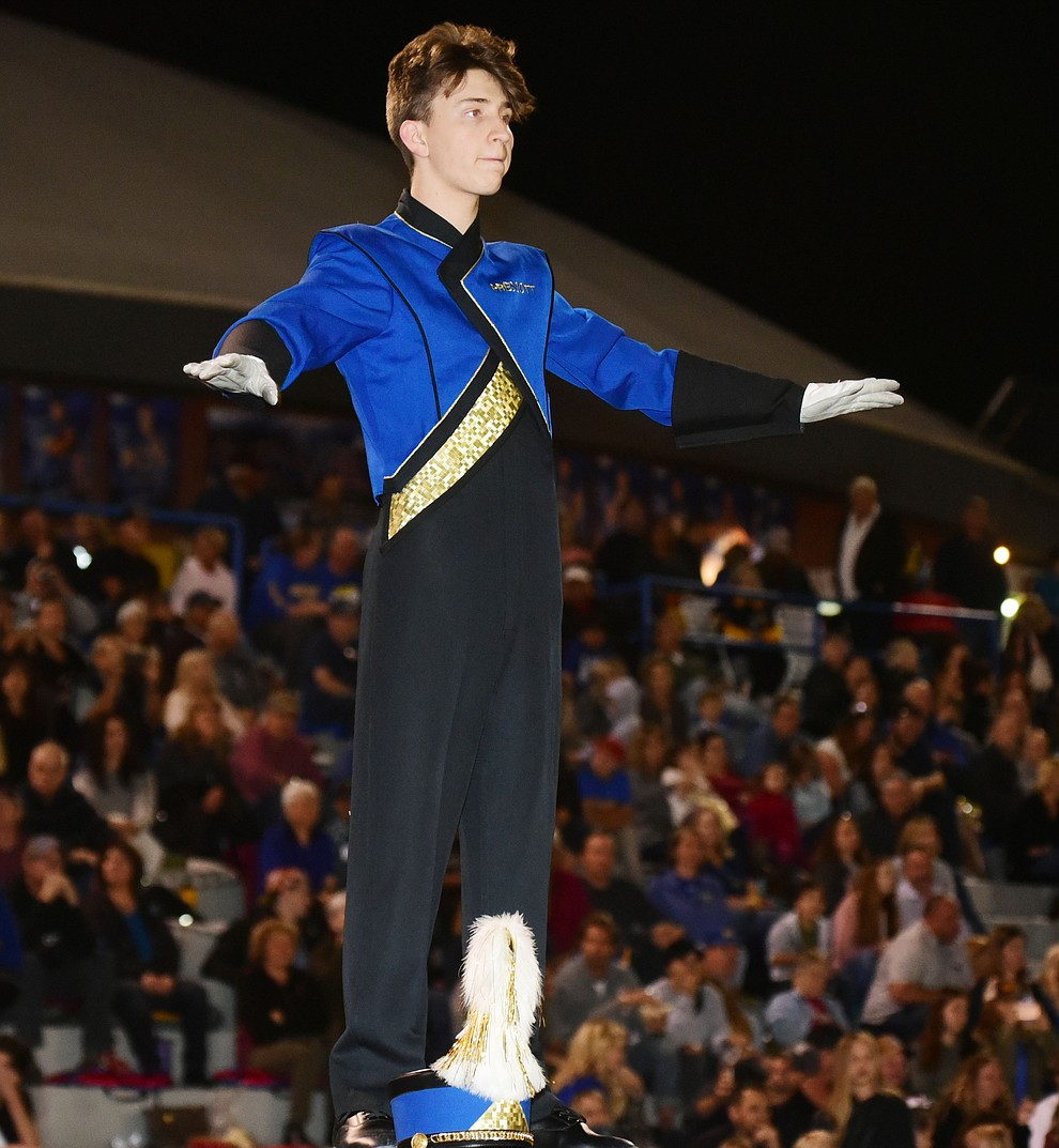 Drum Major Wesley Bradstreet conducts the The Pride of Prescott Marching Band as they perform at halftime as the Badgers play Moon Valley in the 2017 Homecoming game Friday, September 15 in Prescott. (Les Stukenberg/Courier).