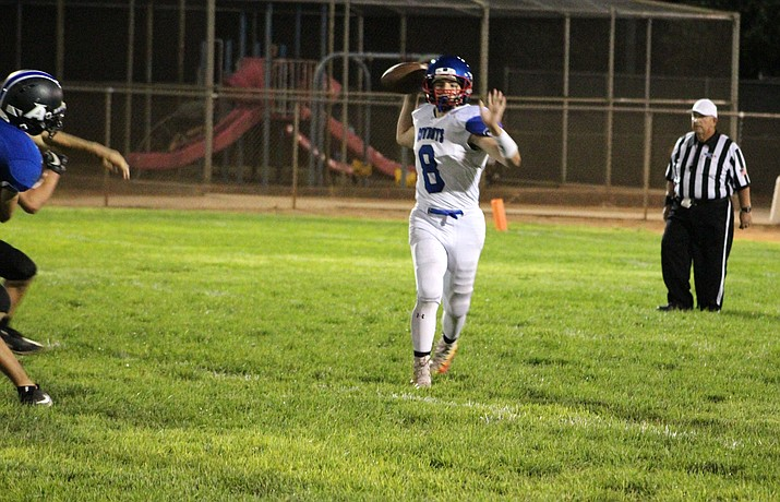 Camp Verde senior Payton Sarkesian passes the ball at Kingman Academy during the Cowboys' 48-0 loss on Friday. Sarkesian was 7-for-22 for 49 yards with an interception. (Kingman Daily Miner/Beau Bearden)