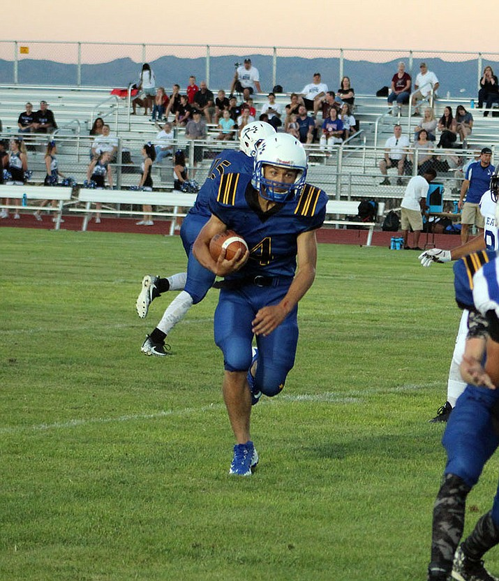Kingman's Austin Dias scored the winning two-point conversion Friday to give the Bulldogs a 20-19 win over ASU Prep.