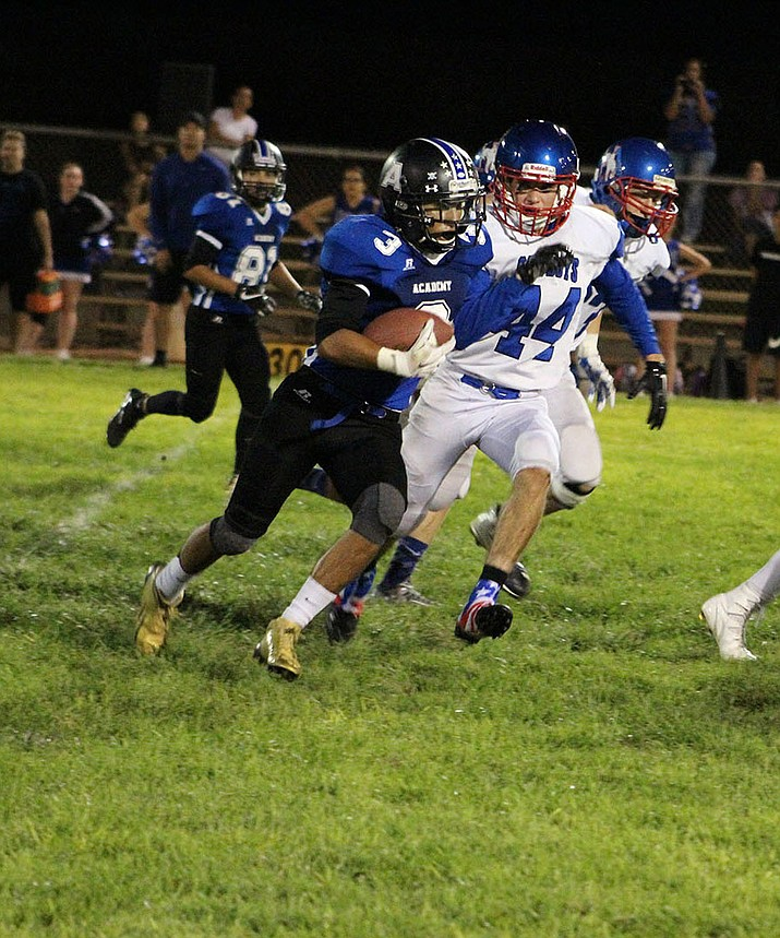 Kingman Academy's Gabe Imus, above, finished with 181 yards receiving and three touchdowns Friday night in a 48-0 win over Camp Verde.