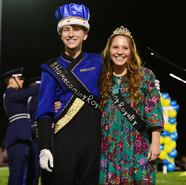 Wesley Bradstreet and Makenna Jex, Prescott High School's 2017 Homecoming King and Queen, pose for the crowd at Friday night's football game.