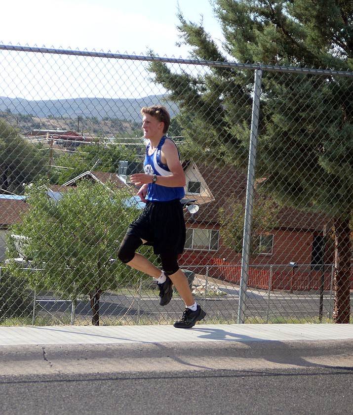 Kingman Academy's Sam Skankey ran an 18:32 at the Parker Multi last week to take first place.