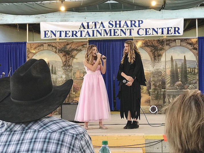 "Mollie and Rylie Taylor perform at ""Kingman's Got Talent"" at the fair Thursday."