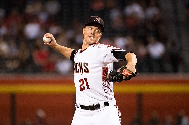 Zack Greinke delivers a pitch against the Rockies on Sept. 11. The right-hander led the D-backs to another win Saturday over the Giants.