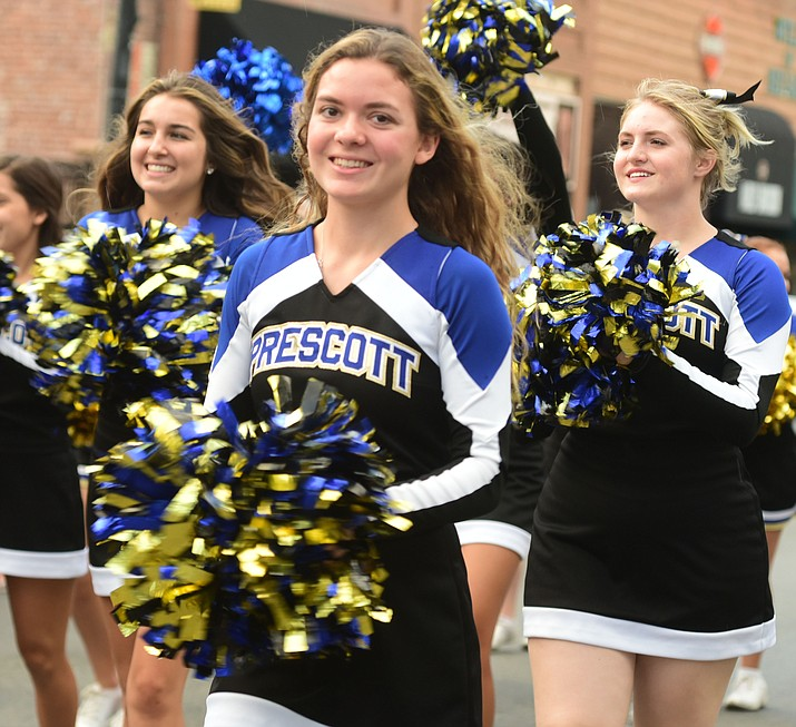 Prescott High School senior Kirsten Hillig marches in the Homecoming parade with fellow cheerleaders Wednesday, Sept. 13 in Prescott. (Les Stukenberg/Courier)