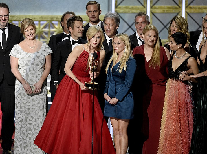"Nicole Kidman, center left, Reese Witherspoon, center right, and cast and crew accept the award for outstanding limited series for ""Big Little Lies"" at the 69th Primetime Emmy Awards on Sunday, Sept. 17, 2017, at the Microsoft Theater in Los Angeles. (Photo by Chris Pizzello/Invision/AP)"