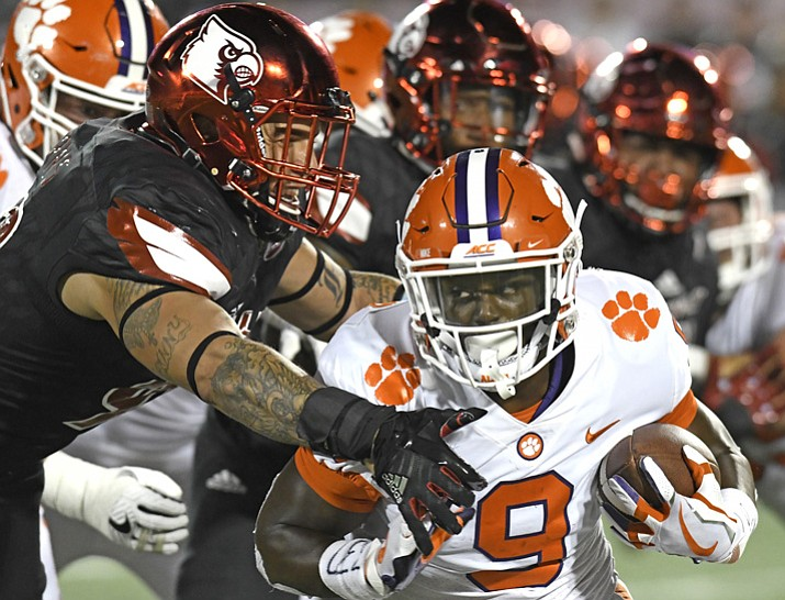 Louisville's James Hearns, left, attempts to tackle Clemson's Travis Etienne (9) during the second half of an NCAA college football game, Saturday, Sept. 16, 2017, in Louisville, Ky. Clemson won 47-21. (Timothy D. Easley/AP)