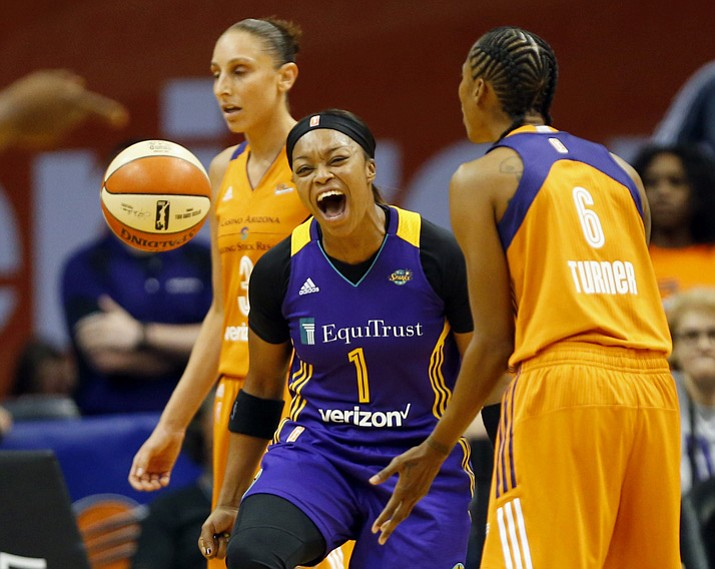 Los Angeles Sparks guard Odyssey Sims (1) celebrates a basket against the Phoenix Mercury in the second quarter of a WNBA basketball semifinals game playoff game in Phoenix, Sunday, Sept. 17, 2017. (Michael Chow/The Arizona Republic via AP)