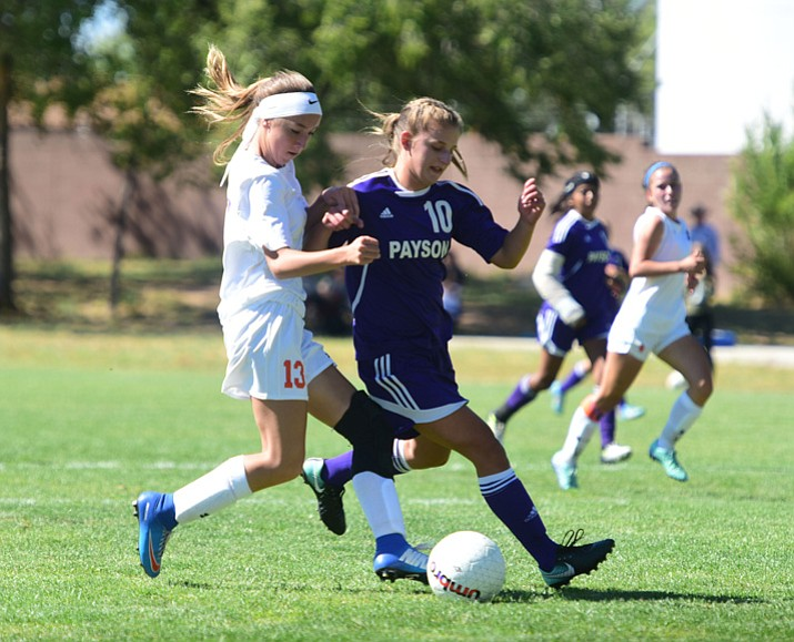 Chino Valley soccer player Jessie Krogh (13) avoids a defender in the first half against Payson on Tuesday, Sept. 19, 2017, in Chino Valley. Krogh scored three goals for a hat trick in an 11-0 win for the Cougars. (Les Stukenberg/Courier)