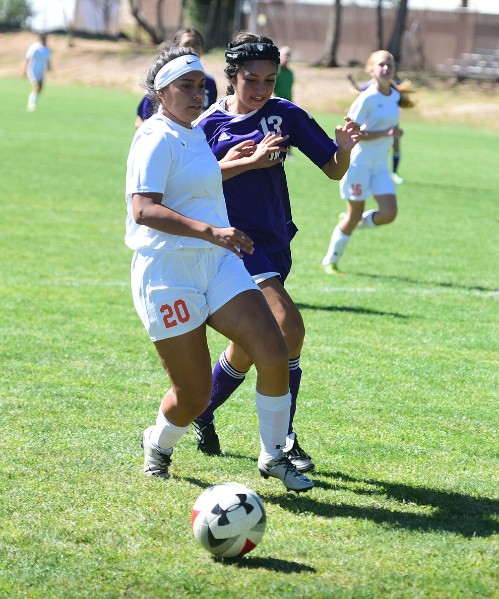 Chino Valley's Crystal Sanchez battles for the ball on the end line as the Cougars routed Payson in a girls soccer matchup Tuesday afternoon in Chino Valley. (Les Stukenberg/Courier)
