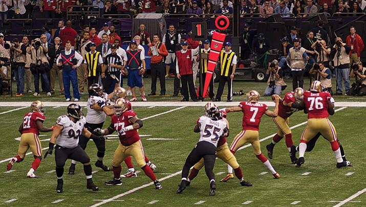 Former San Francisco 49ers quarterback Colin Kaepernick attempts a pass in Super Bowl XLVII.