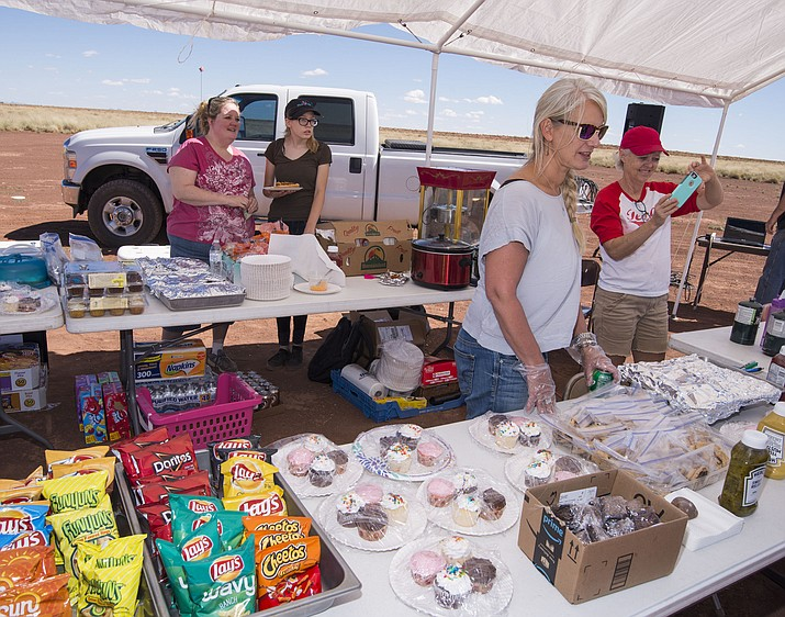 Volunteers sell baked goods and other food to raise money in an effort to move Red Sands School to Winslow for the 2017-2018 school year. School Administrator Brian Snyder said he has heard from parents that the current school is too remote for kids to get to school easily.  Todd Roth/NHO