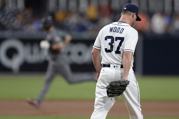 Arizona Diamondbacks' A.J. Pollock rounds the bases after hitting a home run during the first inning as San Diego Padres starting pitcher Travis Wood reacts Tuesday, Sept. 19, 2017, in San Diego. (Orlando Ramirez/AP)