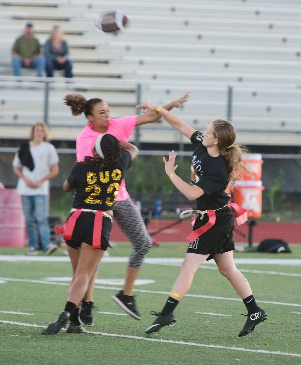 Senior Mica Nellis launches a pass as the seniors played the juniors in Bradshaw Mountain's annual Powderpuff football game Wednesday in Prescott Valley. The juniors won a close fought game 12-6 despite the seniors last minute heroic comeback attempt. (Les Stukenberg/Courier).