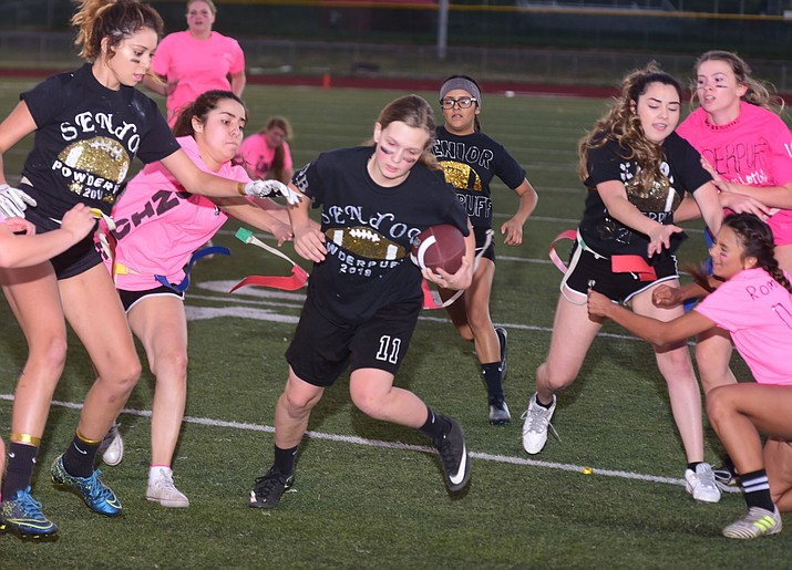 Senior Mica Nellis gets tackled as the seniors played the juniors in Bradshaw Mountain's annual Powderpuff football game Wednesday in Prescott Valley. The juniors won a close fought game 12-6 despite the seniors last minute heroic comeback attempt. (Les Stukenberg/Courier).