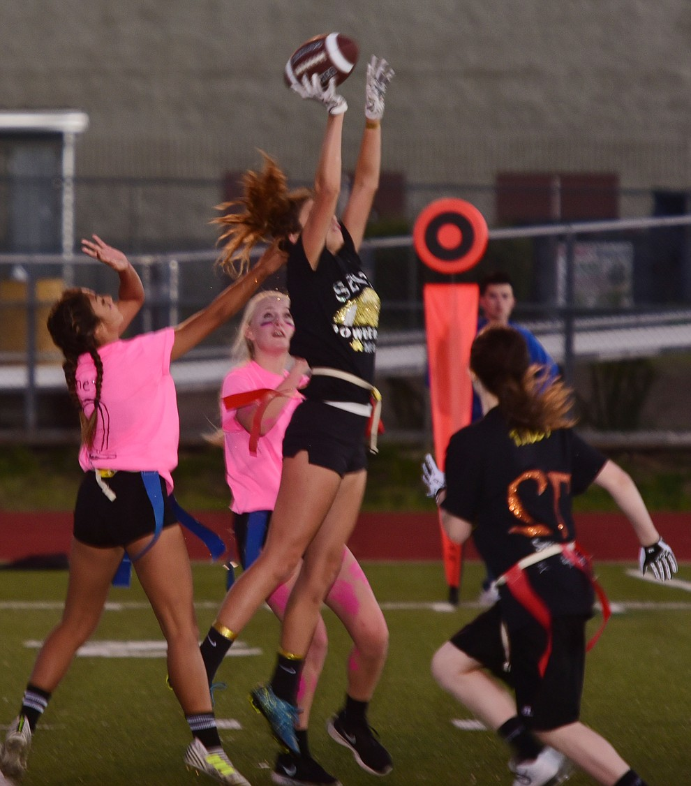 Senior Serena Pelaze just misses a pass as the seniors played the juniors in Bradshaw Mountain's annual Powderpuff football game Wednesday in Prescott Valley. The juniors won a close fought game 12-6 despite the seniors last minute heroic comeback attempt. (Les Stukenberg/Courier).