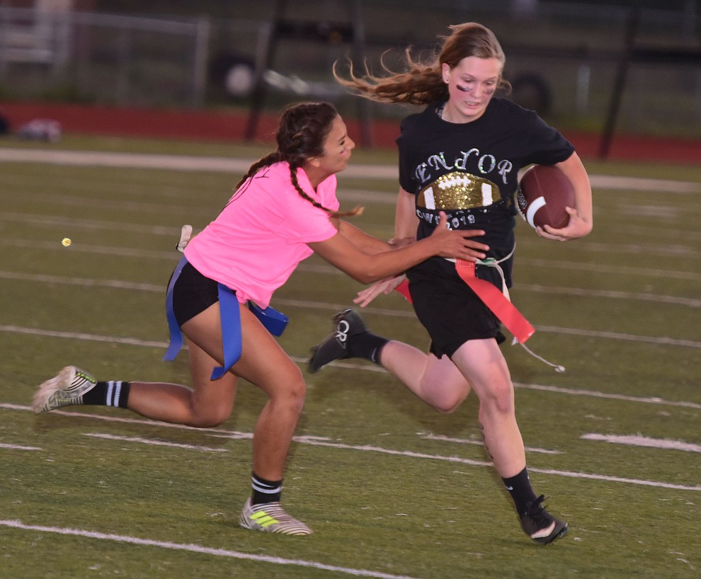 Senior Mica Nellis gets tackled for a loss as the seniors played the juniors in Bradshaw Mountain's annual Powderpuff football game Wednesday in Prescott Valley. The juniors won a close fought game 12-6 despite the seniors last minute heroic comeback attempt. (Les Stukenberg/Courier).