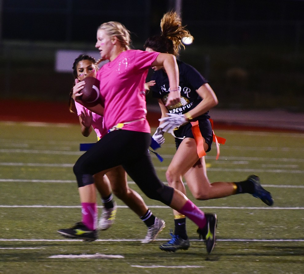 Junior Leigha Campbell makes a crucial catch and run as the seniors played the juniors in Bradshaw Mountain's annual Powderpuff football game Wednesday in Prescott Valley. The juniors won a close fought game 12-6 despite the seniors last minute heroic comeback attempt. (Les Stukenberg/Courier).