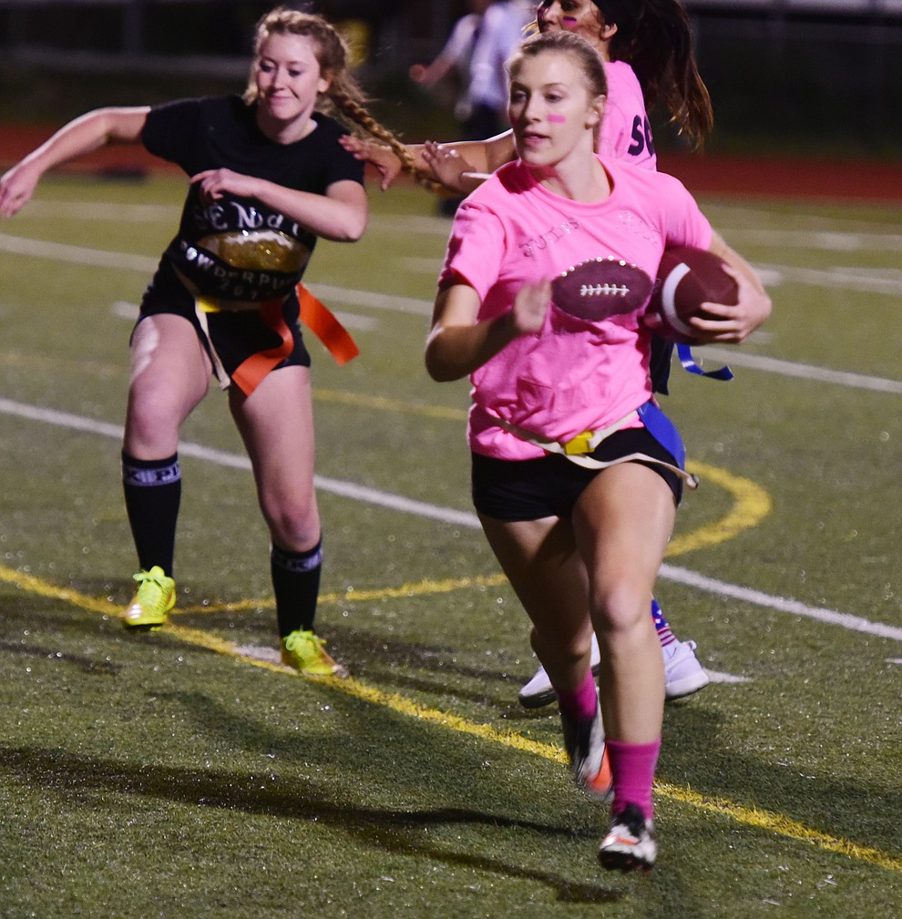 Junior Makenzie Morris heads for another gain as the seniors played the juniors in Bradshaw Mountain's annual Powderpuff football game Wednesday in Prescott Valley. The juniors won a close fought game 12-6 despite the seniors last minute heroic comeback attempt. (Les Stukenberg/Courier).