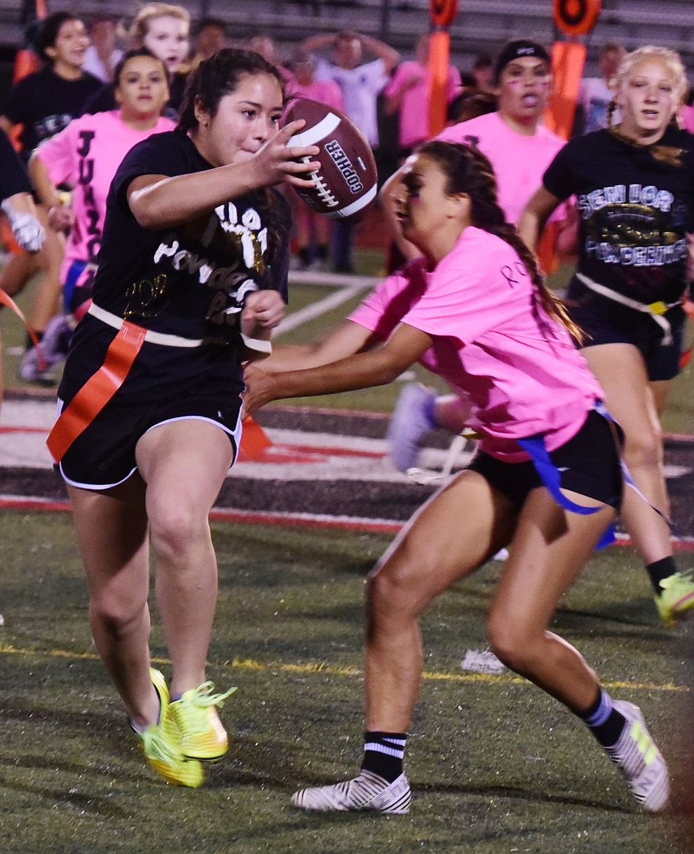 Senior Alejandra Ramirez makes a long runback as the seniors played the juniors in Bradshaw Mountain's annual Powderpuff football game Wednesday in Prescott Valley. The juniors won a close fought game 12-6 despite the seniors last minute heroic comeback attempt. (Les Stukenberg/Courier).