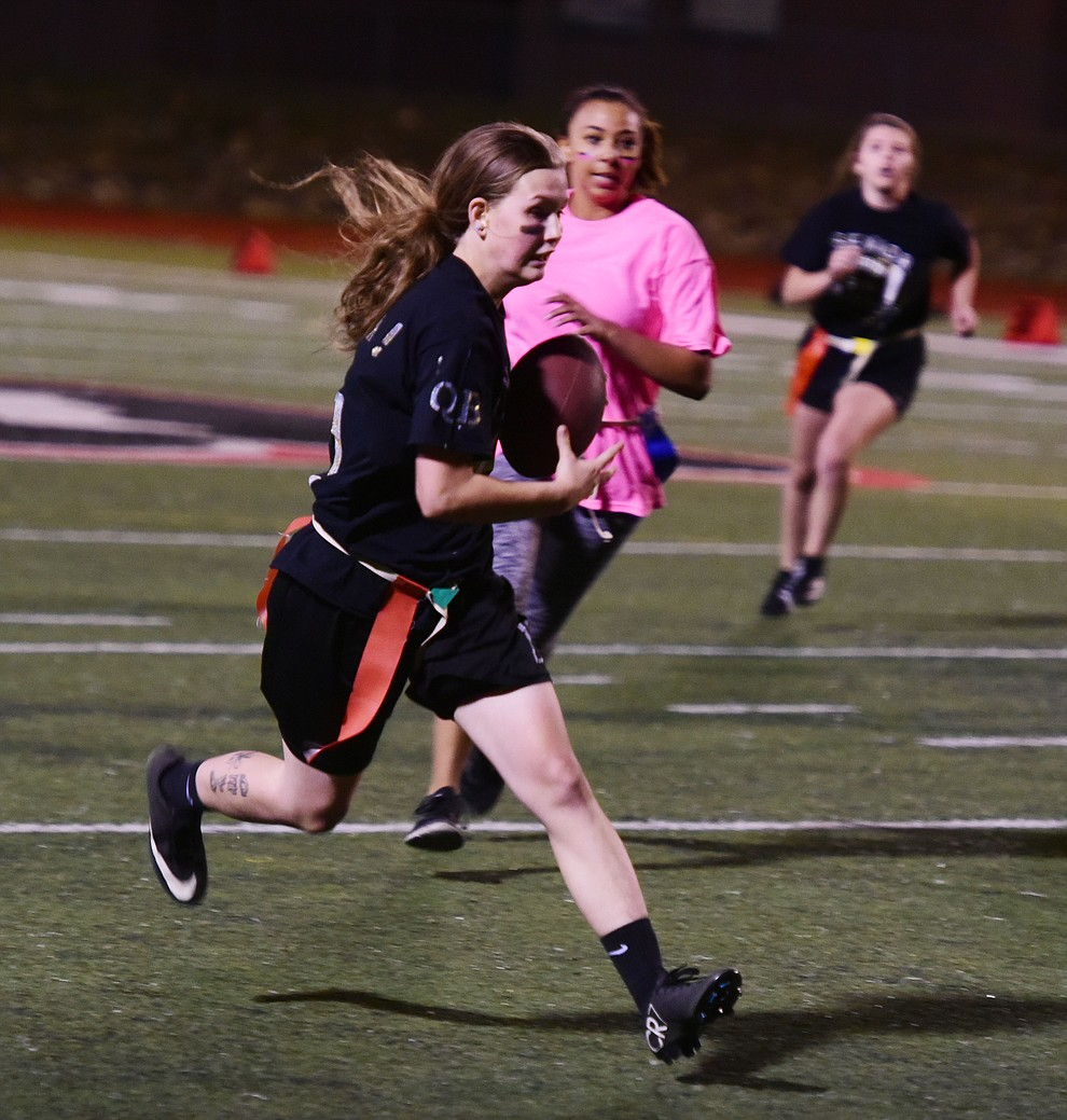Senior Mica Nellis runs for a crucial first down as the seniors played the juniors in Bradshaw Mountain's annual Powderpuff football game Wednesday in Prescott Valley. The juniors won a close fought game 12-6 despite the seniors last minute heroic comeback attempt. (Les Stukenberg/Courier).