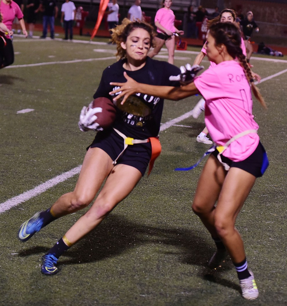 Senior Serena Pelaze makes another catch and run as the seniors played the juniors in Bradshaw Mountain's annual Powderpuff football game Wednesday in Prescott Valley. The juniors won a close fought game 12-6 despite the seniors last minute heroic comeback attempt. (Les Stukenberg/Courier).