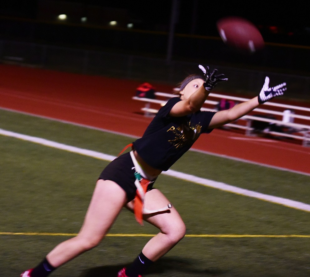 Senior Courtney Stanley just misses a catch to tie the game as the seniors played the juniors in Bradshaw Mountain's annual Powderpuff football game Wednesday in Prescott Valley. The juniors won a close fought game 12-6 despite the seniors last minute heroic comeback attempt. (Les Stukenberg/Courier).