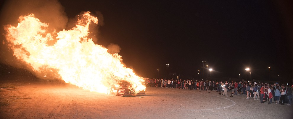 Bradshaw Mountain students gather for the annual bonfire as part of Homecoming week at the Prescott Valley School. (Les Stukenberg/Courier).