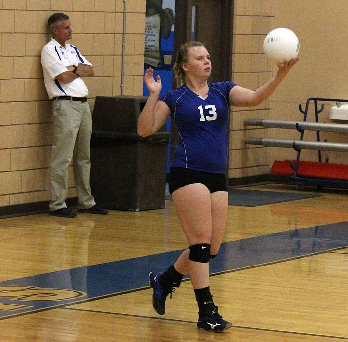 Camp Verde senior Jade Oium serves during the Cowboys' 3-0 loss to Northland Prep on Tuesday night. (VVN/James Kelley)