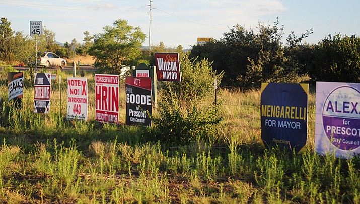Campaign signs are visible along local streets, including Willow Creek Road and Pioneer Parkway. (Les Stukenberg/Courier, file)