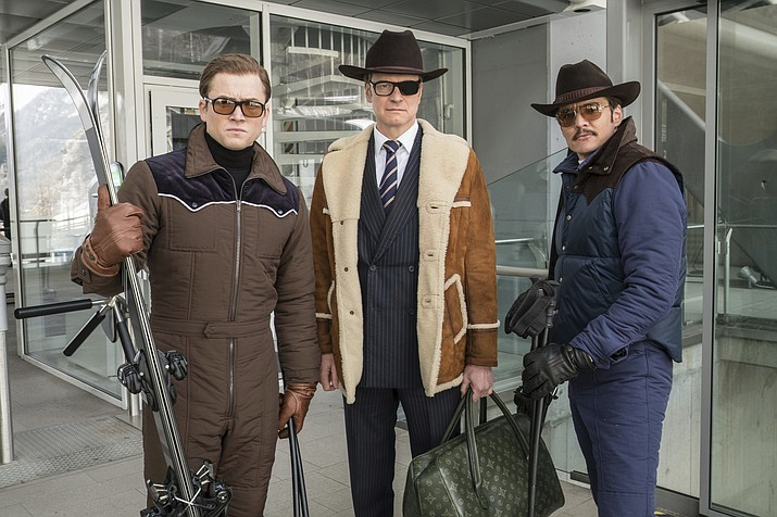 "This image released by Twentieth Century Fox shows, from left, Taron Egerton, Colin Firth, and Pedro Pascal in ""Kingsman: The Golden Circle."" (Giles Keyte/Twentieth Century Fox via AP)"