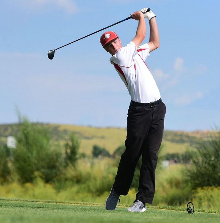 Mingus Union's Justin Tanner hits his tee shot as they played the Kingman and Prescott High Schools at Antelope Hills Golf Course in Prescott Tuesday, September 5.  (Les Stukenberg/Courier)