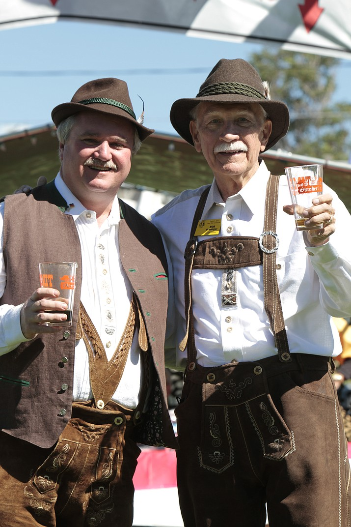 Chris Kuknyo, former Prescott City Council member and chairman of the Prescott-Zeitz sister cities committee, and Bob Greninger, director of Prescott's Sister City Programs and member of the honorary board of Sister Cities International, pose at the 2016 Oktoberfest. (Courtesy)