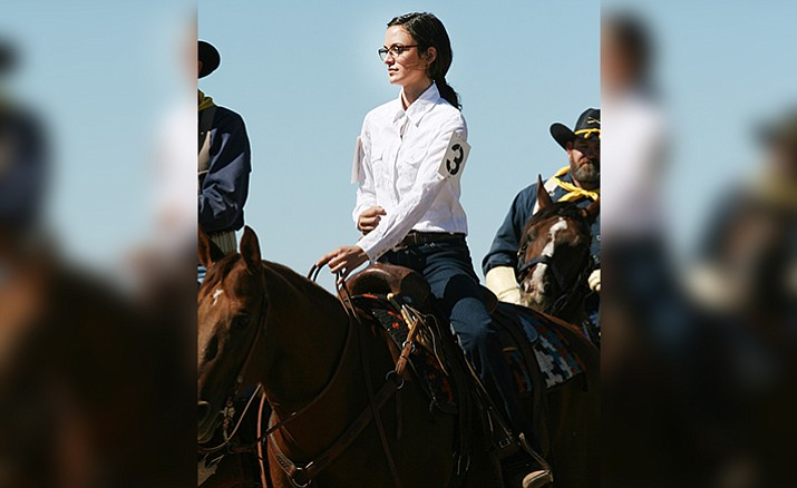 Alana Neary shows the poise, personality and horsemanship that helped her win last year's Colonel's Daughter competition at the parade grounds of Fort Verde State Historic Park. (Photo by Bill Helm)