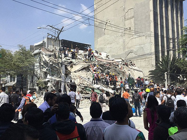 Volunteers and rescuers working at collapsed building at Colonia Roma, Mexico City. The official death toll from Tuesday's 7.1 earthquake was at 273 Thursday.