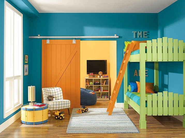 This undated photo provided by Sherwin-Williams shows a a child's bedroom painted in Sherwin-Williams' color called Loch Blue. (Sherwin-Williams via AP)
