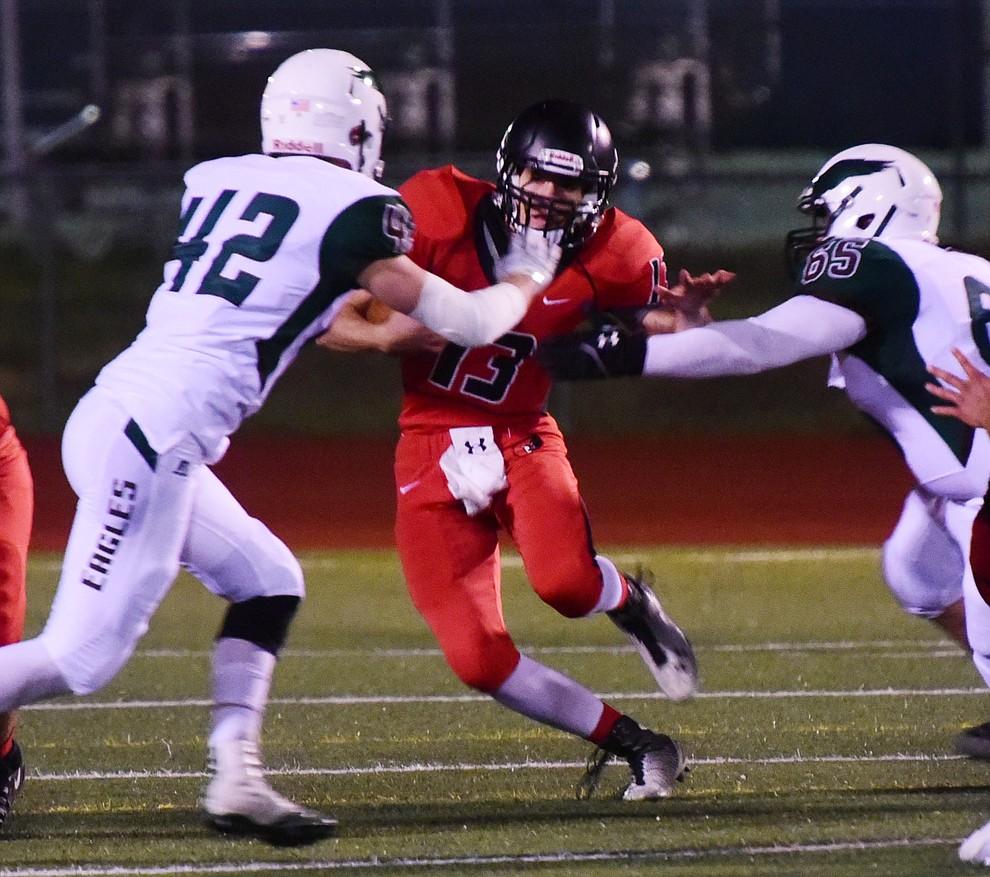 Bradshaw Mountain's Austin Gonzalez (13) cuts through the defense as the Bears take on Flagstaff Friday, September 22 in Prescott Valley. (Les Stukenberg/Courier)