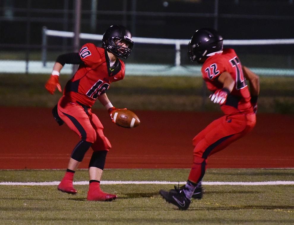 Bradshaw Mountain's Devon Olsen (10) and Bryan Price (22) celebrate a first half touchdown as the Bears take on Flagstaff Friday, September 22 in Prescott Valley. (Les Stukenberg/Courier)