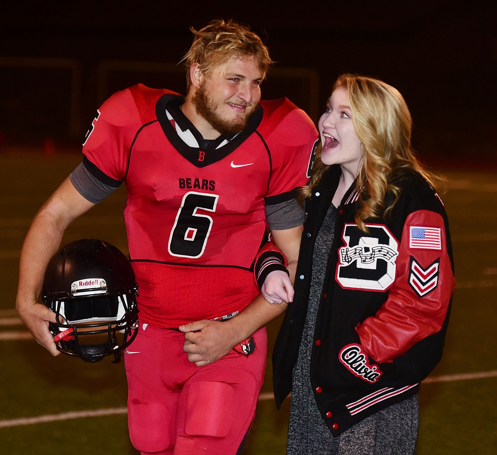 Bradshaw Mountain's 2017 Homecoming King and Queen Timmy Young and Olivia Keeting react to the announcement during halftime of the game against Flagstaff Friday, September 22 in Prescott Valley. (Les Stukenberg/Courier)
