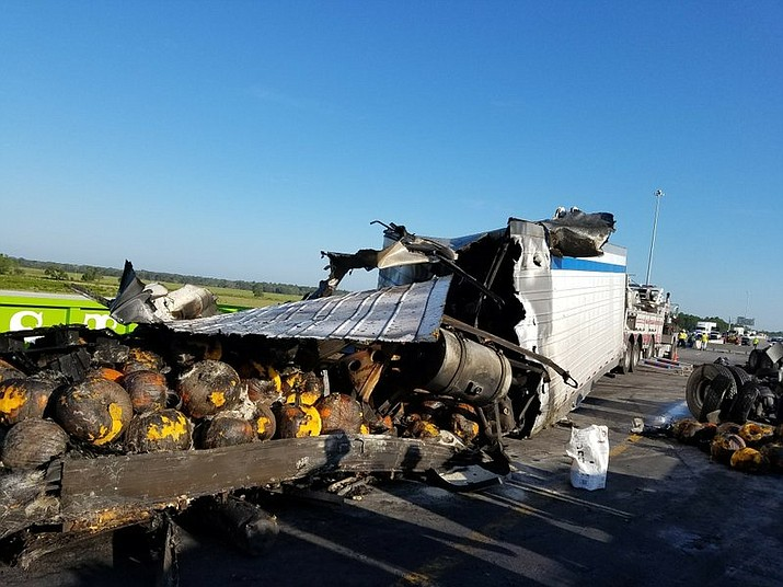 A truck carrying pumpkins hit a guard rail on I-75 near Tampa, Fla. Friday. The truck then exploded, spilling the burning pumpkins onto the highway. (Florida Highway Patrol via AP)