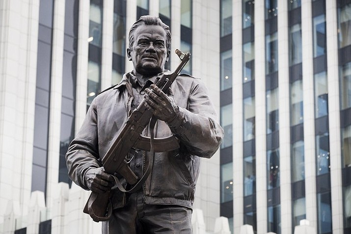 In this Tuesday, Sept. 19, 2017 file photo, a new monument of Russian firearm designer Mikhail Kalashnikov is unveiled during an official ceremony in Moscow, Russia. Just days after a monument honoring AK-47 designer Mikhail Kalashnikov was unveiled in Moscow, workers have removed a part of it that showed a German weapon that many believe inspired the renowned assault rifle. (AP Photo/Pavel Golovkin, File)