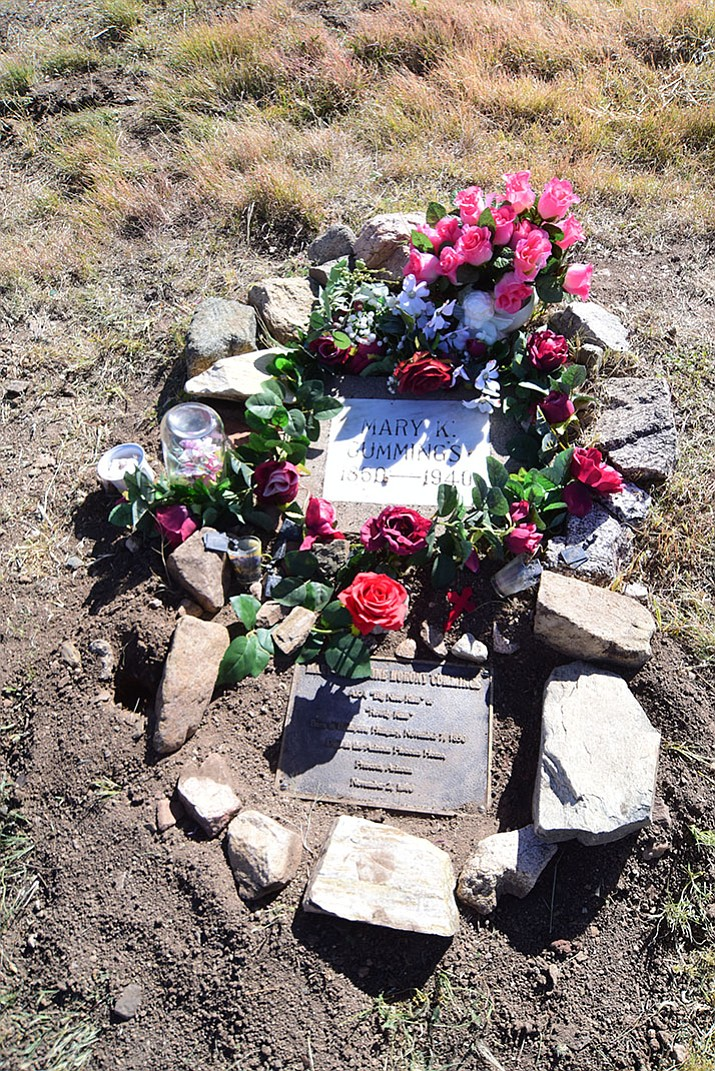 The gravesite of Mary Cummings, aka Big Nose Kate, that was reportedly vandalized actually was just covered over with weeds and dirt, it's now been uncovered at the Arizona Pioneer's Home Cemetery in Prescott.